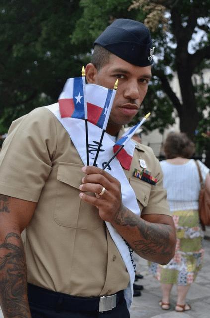MA at Alamo with Texas flags-min